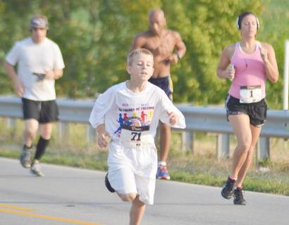 Nash Johnson of Greensburg runs in the race.
