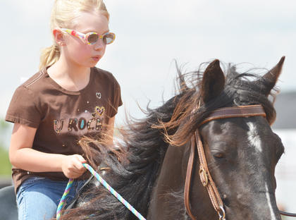 Hannah Marcum of Campbellsville rides her horse.