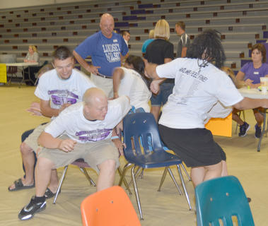 CHS graduates rush to get a seat at musical chairs.
