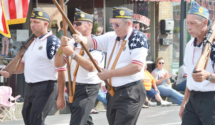 American Legion Post 82 members march in the parade.