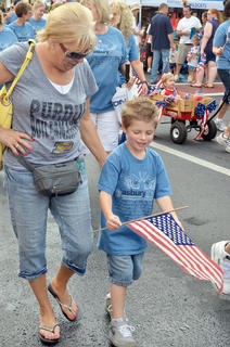 Asbury Church members, who sponsored the event, walk in the children's parade.