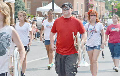 Campbellsville and Taylor County high school bands march and play patriotic music for the crowd.