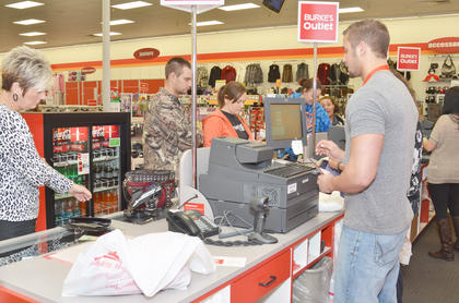 Shoppers at Burke&#039;s Outlet take their purchases to cashiers.
