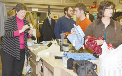 At Mitchell's Men's Wear, shoppers take advantage of savings. The early birds on Friday morning got 50 percent off their purchases.