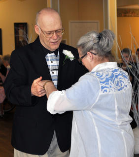 Bluegrass Way resident Mike Harmon dances with Jo Ann Armel, activities coordinator, at Bluegrass Way Assisted Living prom on Saturday.