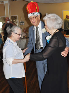 Jo Ann Armel, activities coordinator, dances with prom king Milton Shuffett and prom queen Doris Holt at Bluegrass Way Assisted Living prom on Saturday.