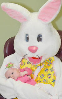 The Easter Bunny holds Addalyn Young, 2 months old, of Campbellsville, while posing for a photo.