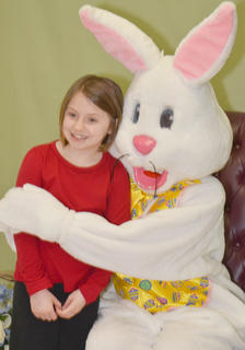 They laughed, danced and ate pancakes. Taylor County Extension Office hosted Breakfast with the Easter Bunny on Saturday. The line to meet the man was lengthy, with many Campbellsville children excited to meet him. Leigh Hicks of Campbellsville gets a hug from the Easter Bunny.