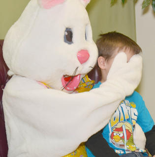 The Easter Bunny covers Campbellsville resident Landon Benningfield's eyes in an attempt to make him laugh.