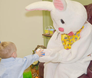 Jacob Sandidge of Campbellsville gives the Easter Bunny an Easter egg.
