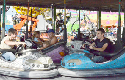Fairgoers smash together at the Bumper Cars.
