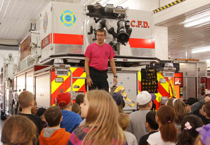 Tony Grider, an engineer with the Campbellsville Fire Department, talks to students from Campbellsville Elementary School during their visit to the fire department.