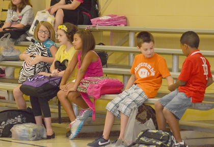 Campbellsville Elementary School students wait in the multi-purpose room to go eat breakfast or go to their classrooms.