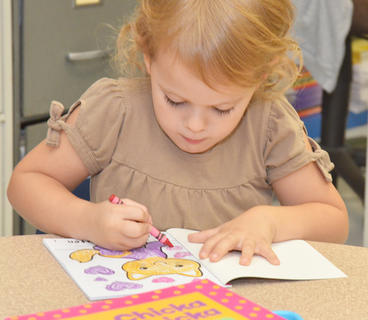 Campbellsville Elementary School kindergartener Ellie Wise colors a kitten before the school day begins.