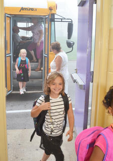 Campbellsville Elementary School students, led by Chloe Bennett, walk into the multi-purpose room after riding the bus to school.