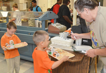 Campbellsville Elementary School kindergarteners get their breakfast in the cafeteria.
