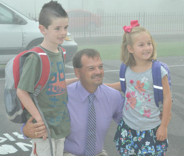 Campbellsville Elementary School students Parker and Keeley Polk pose for a photo with their principal, Ricky Hunt.
