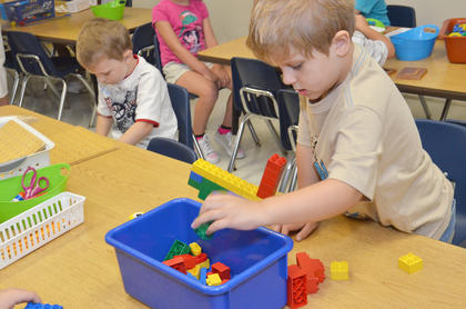 Campbellsville Elementary School kindergartener Zeke Harris plays with Legos before the school day starts.