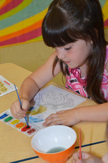 CES kindergarten student Lauren Pace paints a picture on her first day of school.