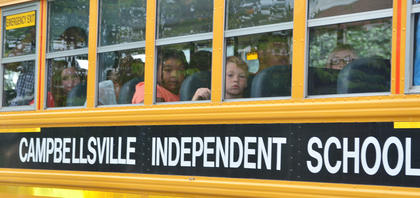 Campbellsville Independent students wait to get off the bus for their first day of school.