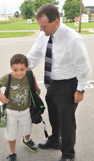 CES Principal Ricky Hunt greets students as they come to school on Tuesday morning.
