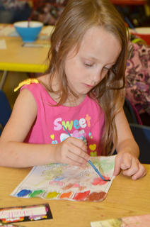 CES kindergarten student Shelby Grubaugh paints in Chanci Patterson's classroom.