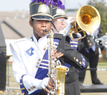 Thirteen area bands competed at the annual Taylor County Marching Invitational on Saturday at Taylor County High School. From left, Campbellsville High School saxophone player Kalup Cowan and horn player Glen Hooper play during Saturday&#039;s performance, which earned the band first-place honors.