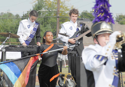 Thirteen area bands competed at the annual Taylor County Marching Invitational on Saturday at Taylor County High School. From left, CHS band percussionist Dalton Adkins, color guard member Victoria Noyola, bass player Nathan Riggs and trumpet player Murphy Lanham, perform.