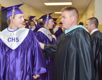 Bradley Bates, at left, talks with Campbellsville High School teacher Dale Estes before the ceremony.