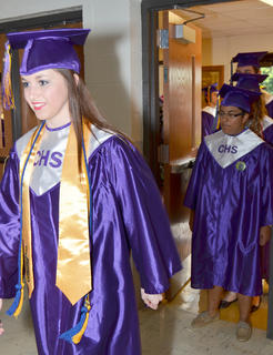 Cassidy Blair smiles as she walks into Hamilton Auditorium to get her high school diploma.