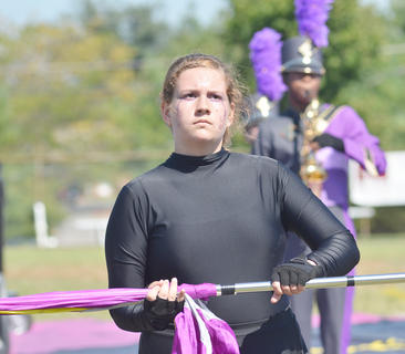 CHS color guard member Rebekah Cowherd performs with the CHS band.