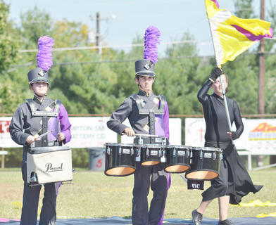 Drumline members Abby Hieneman, at left, and Dalton Adkins perform with the CHS band.