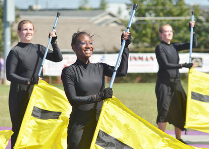Eight area bands competed at Taylor County High School on Saturday, Sept. 22, with the LaRue County High School band coming out on top as grand champion. In preliminary competition, Campbellsville High School received the best percussion award and first-place honors. In finals competition, Campbellsville placed fifth. Glasgow High School received the reserve grand champion trophy. TCHS and Campbellsville University bands performed in exhibition. Above, from left, color guard members Rebekah Cowherd, Takishia Clayton and Ashley Bottoms perform with the CHS band.