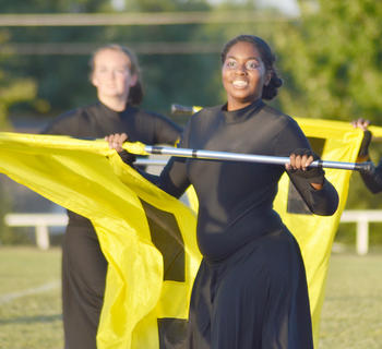 Color guard member Dayla Scott performs with the CHS band.