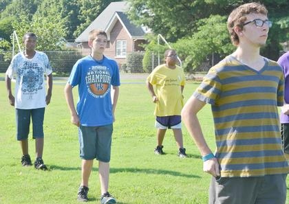 From left, CHS marching band members Kalup Cowan, Murphy Lamb, Ricky Smith-Cecil and Glen Hooper practice fundamentals at band camp on Tuesday.