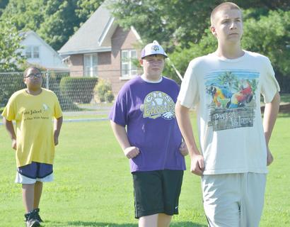 CHS marching band members, from left, Ricky Smith-Cecil, Austin Belt and Anthony Drew march during band camp on Tuesday.