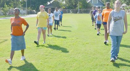 CHS marching band members practice a drill at band camp on Tuesday.