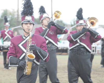 Thirteen area bands competed at the annual Taylor County Marching Invitational on Saturday at Taylor County High School. Alto saxophone player Daniel Beams of Campbellsville plays with the CU marching band.