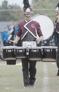 Thirteen area bands competed at the annual Taylor County Marching Invitational on Saturday at Taylor County High School. Tenor player Austin Yates of Campbellsville performs with the Marching Tigers on Saturday.