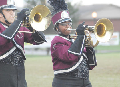 Thirteen area bands competed at the annual Taylor County Marching Invitational on Saturday at Taylor County High School. From left, mellophone player Mitchell Monroe of Morganfield and baritone player Sarah Porter of Harrodsburg perform in exhibition.