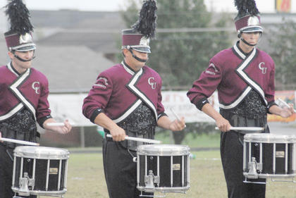Thirteen area bands competed at the annual Taylor County Marching Invitational on Saturday at Taylor County High School. From left are CU snare drum players David Theaker of Danville, Trevor Ervin of Glasgow and Kyle Becknell of Nicholasville.