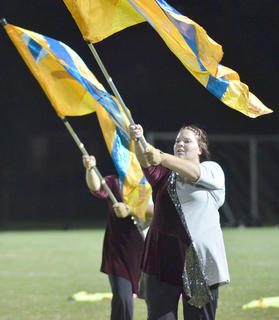 Kelly Buck, a CU student from Monticello, performs with the color guard.