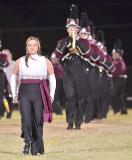 CU marching band field commander Jenna Embry of Leitchfield leads her band onto the field.