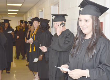 Tiffani Ayers of Louisville lines up with her fellow graduates on Saturday before the graduation ceremony begins. Ayers received a Bachelor of Science degree in Christian social ministries.