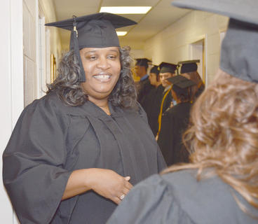 Rosalind Strong-Porter of Campbellsville shares a laugh with a fellow graduate before she receives her Bachelor of Social Work degree on Saturday.