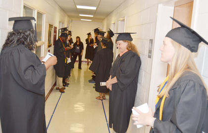 Graduates line up before the start of Saturday's graduation ceremony.