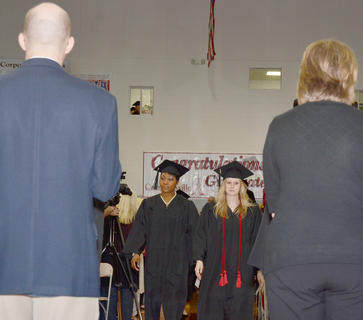 Graduates walk to their seats at Powell Athletic Center on Saturday morning.