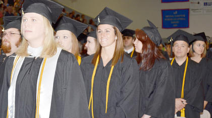 Courtney Clifton, center, smiles as the graduation ceremony begins on Saturday. Clifton, of Lexington, received a Bachelor of Science degree in biology.