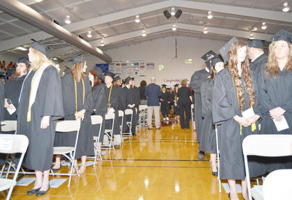 Graduates wait for the start of Saturday's ceremony.