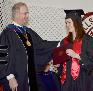 Emily Shultz of Campbellsville is congratulated by Dr. Michael Carter, CU's president, after she receives her Bachelor of Science degree in political science and history.